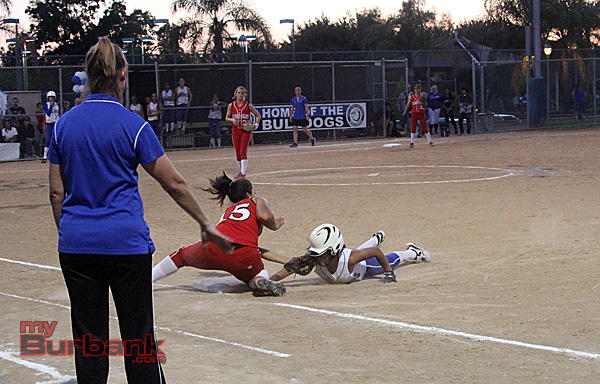 A Burbank runner slides safely under the tag of Burroughs' Aimee Rodriguez (Photo by Ross A. Benson)