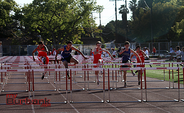 Dennis Palacio of Burbank wins the boys 110 High Hurdles (Photo by Ross A. Benson)