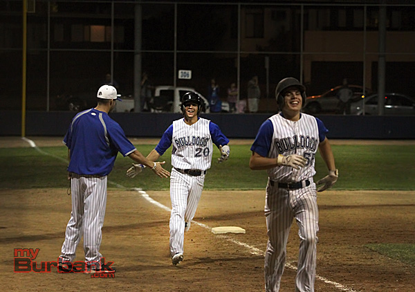Ricky Perez, #20, jogs home after his three-run home run (Photo by Ross A. Benson)