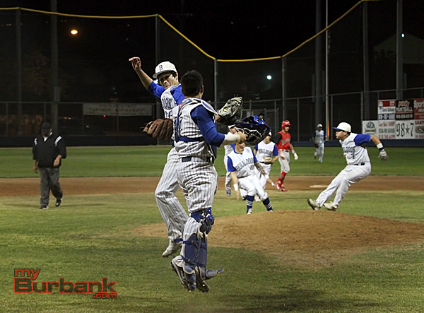 Ricky Perez celebrates with Hector Rodriguez in Burbank's 8-6 win (Photo by Ross A. Benson)