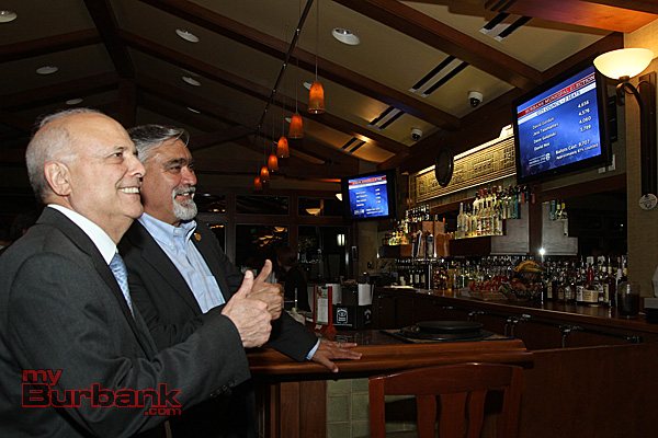 Bob Hope Airport Commissioner Frank Quintero joins Councilman Jess Talamantes with a thumbs up looking at the results at The DeBell Clubhouse. (Photo by Ross A. Benson)