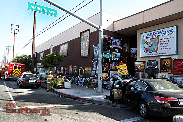 Accident causes cars to come to rest in doorway of Art-Wave Warehouse at Alameda Ave & Victory Blvd Friday afternoon. (Photo by Ross A. Benson)