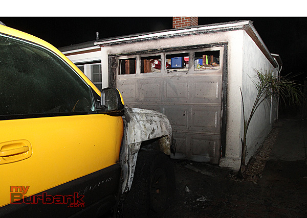 Truck fire almost spreads to this attached garage early Monday morning. (Photo by Ross A. Benson)