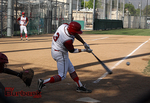 Brian Pozos connects on a double (Photo by Dick Dornan)