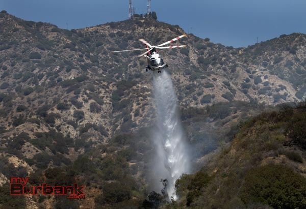 Los Angeles City Copter 5 makes a drop on a small brush fire that occurred Monday afternoon near DeBell golf corse. (Photo by Ross A. Benson)