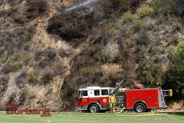 Burbank Engine 16 supplies water to a fellow crew member right above. (Photo by Ross A. Benson)