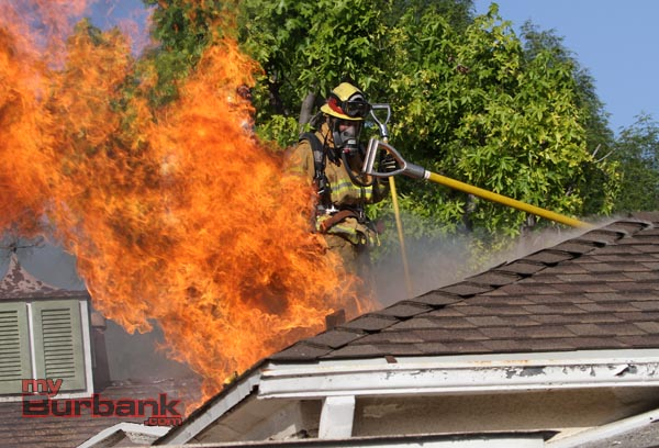 Burbank Firefighters work at ventilating this attic fire at a residence in the 700 Blk of Kenwood Street Thursday afternoon. (Photo by Ross A. Benson)