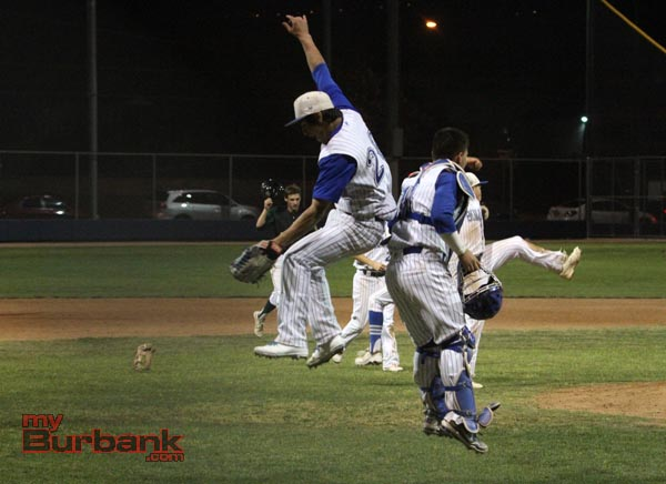 Ricky Perez and Hector Rodriguez celebrate the final out (Photo by Ross A. Benson)