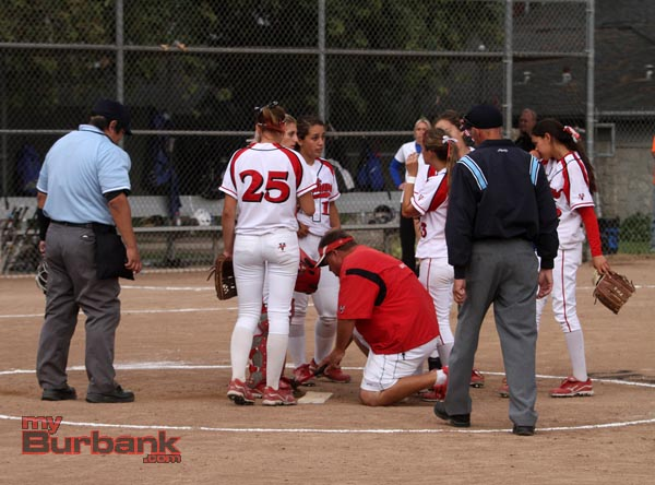 Burroughs coach Doug Nicol had his hands full with the game and the rubber (Photo by Ross A. Benson)