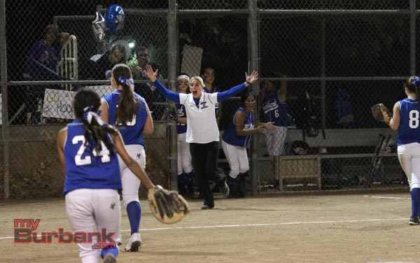 Nicole Drabecki runs out of the dugout with her arms wide open after the Bulldogs won their first league title since 1987 (Photo by Ross A. Benson)
