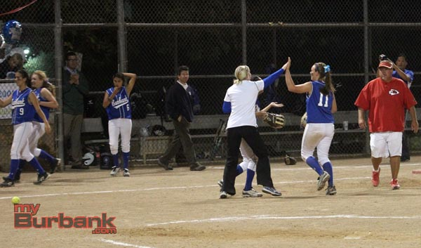 Players celebrate their undefeated season with Coach Drabecki (Photo by Ross A. Benson)