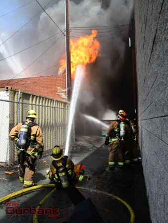 Firefighters used tons of waters in an attempt to extinguish a 4th alarm fire at Beauty Kiss Carpets. (Photo by Ross A. Benson)