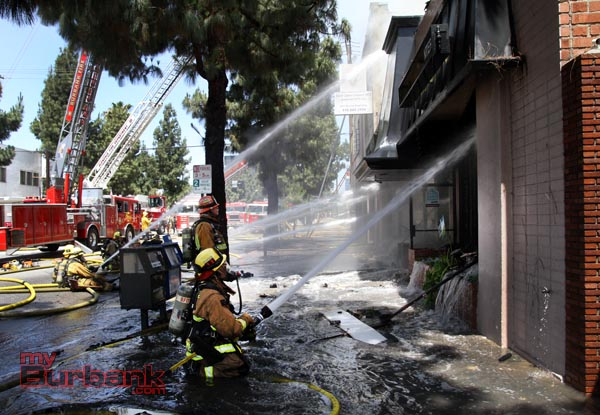 Seventy firefighters or more from cities as far away as Alhambra assisted in this 4 alarm blaze that destroyed Beauty Kiss Carpets Monday. (Photo by Ross A. Benson)
