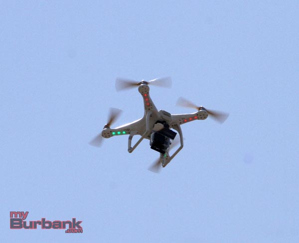 Drone with a camera mounted on it flying over the fire scene. (Photo by Ross A. Benson)