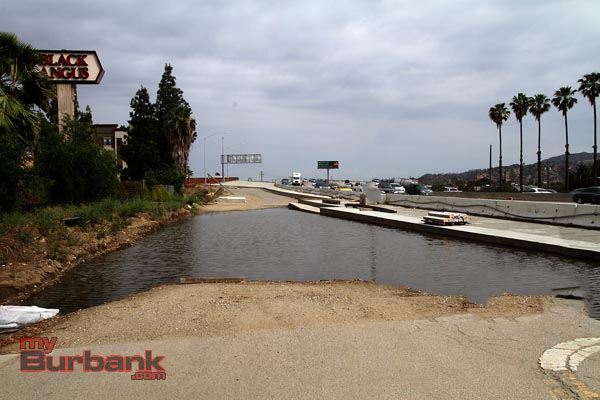 I can hear Andy & Opie whistling their favorite Andy Griffith song.. This is the boat ramp to Burbank's new lake. Nice Palm trees, and a Black Angus just a rock throw from the dock, hope it doesn't dry up before you get to see it. Look to the right as you go East of the Olive Overpass.. (Photo by Ross A. Benson)