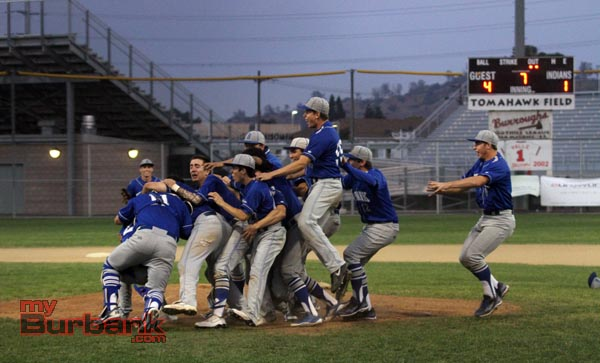 Burbank players rush the mound to celebrate the league title (Photo by Ross A. Benson)