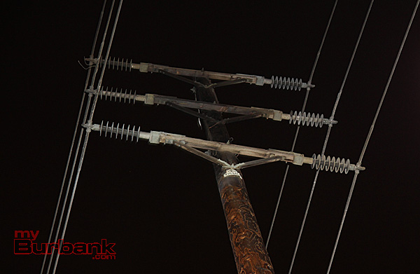 Darken marks on electrical pole shows where a an electrical charge caused a surge after a balloon came in contact with a 64 KV charged line. (Photo by Ross A. Benson)
