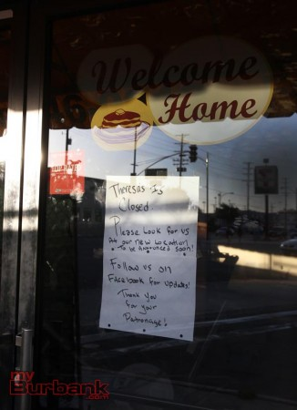 Sign on the front door says Theresa's is CLOSED and Thanks people for their patronage, and says look for them soon at a unknown location. (Photo by Ross A. Benson)