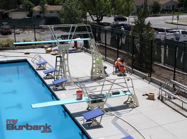 Diving Board and starting blocks in place, additional installations being completed for opening. (Photo by Ross A. Benson)