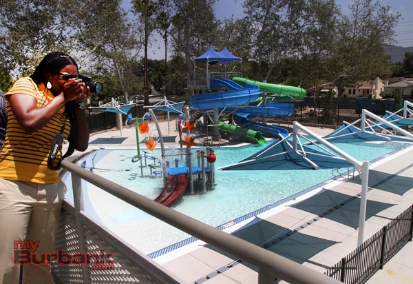 Amanda Okafor with the City of Burbank's  PIO office captures a couple of 'Kodak' moments preparing for the opening of the new slides at the Verdugo Park pool.(Photo by Ross A. Benson)