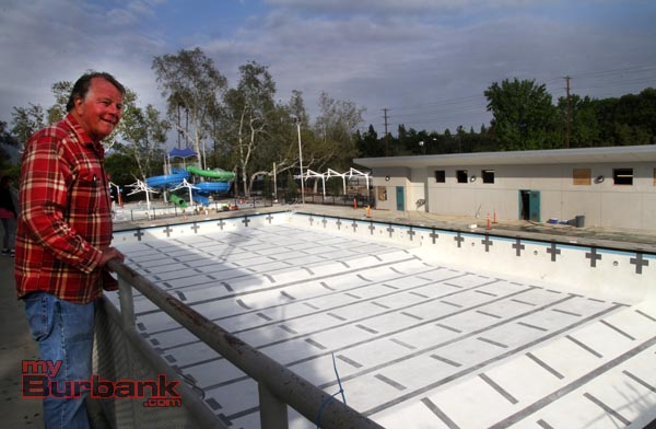 Long time Burbank resident Peter Frith-Smith who lives across the street from the Verdugo Pool has watched the progress daily, finally glad to see water being added. (Photo by Ross A. Benson)