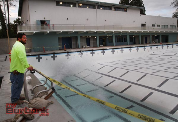 Luke Lewallen of California Commercial Pools watches as water starts filling the 50 miter pool, that was plastered on Wednesday. (Photo by Ross A. Benson)