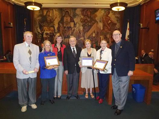 Older American Volunteer Service Awardees honored at City Council Meeting (Left to right): Senior Board member Doug Halter; Awardee Sue Stimpson; Mayor Emily Gabel-Luddy; Senior Board member Peter McGrath; Awardees Peg Setti and Sandy Struble; and Senior Board member Bill Anderson