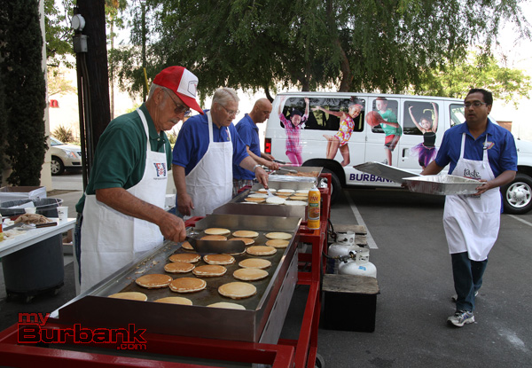 Cooking up pancakes and sausage for over 600 guests. (Photo by Ross A. Benson)