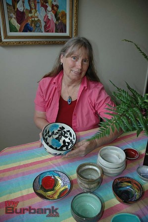 Ellisa Weekley, of Burbank, with several bowls she has made for the Family Promise Empty Bowl fundraiser on June 2. (photo by Joyce Rudolph)