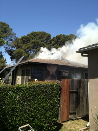 Upon arrival, Truck 11 reported heavy smoke coming from the top of the residence on Monterey Ave.