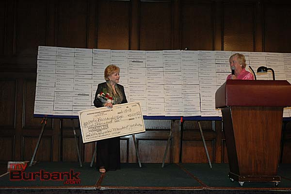 Debbie Reynolds holds the $5,000 check presented by Kiwanis Club Gala Chairwoman Marsha Jackson, right, to Burroughs High School  (Photo By Joyce Rudolph)