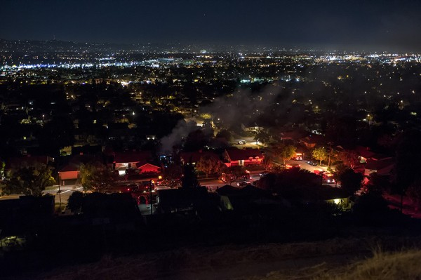 Reader Mike Elman sent in this photo of the fire with the city in the background