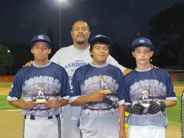 (Left to Right) Justin Palafox, Nathan Palafox and David Phillips with Coach Jose Sandoval. All players are from the Sandoval Dodgers Elite (Photo courtesy of Jason Dyer)