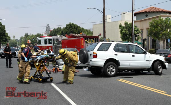 Burbank Paramedics rush to an awaiting rescue ambulance, to get this victim to a local hospital for treatment. (Photo by Ross A. Benson)