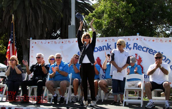 Mayor Emily Gabel-Luddy leads the cheers at the Ponytail ceremonies (Photo by Ross A. Benson)