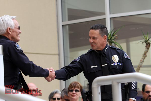 Chief LaChasse is congratulated by Chief Kim Raney Covina Police Chief and President, California Police Chief's Association. (Photo by Ross A. Benson)