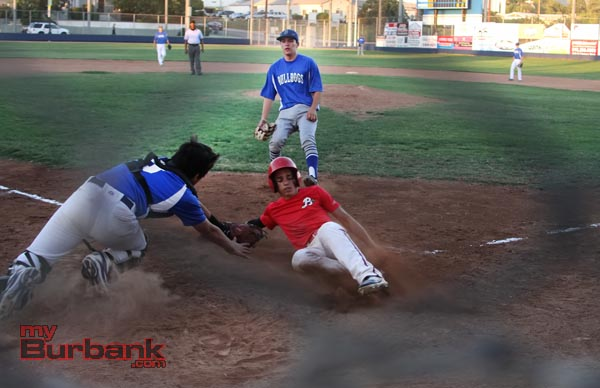 Burroughs' Andres Cano slides in safely at home just before the tag (Photo by Ross A. Benson)