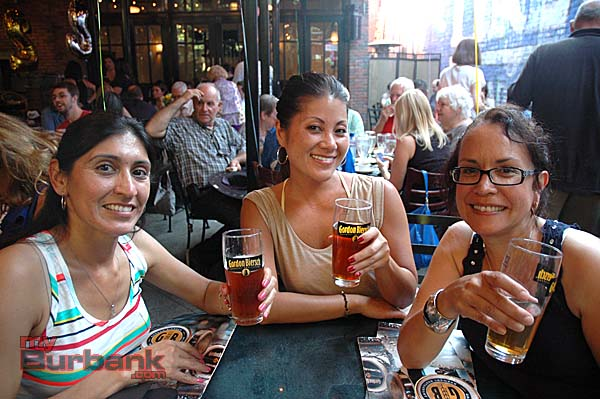 Boys & Girls Club supporters, from left, Sandi Sutter, Leslie Melchor and Sonia Arce toast during the fundraiser Tuesday night at Gordon Biersch. (Photo by Joyce Rudolph)