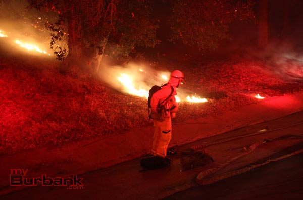 Burbank Firefighter checks his safety gear prior to attacking the brush fire near Wildwood Cyn. (Photo by Ross A. Benson)