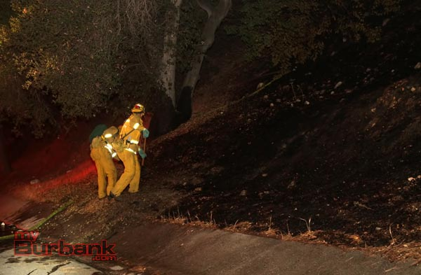 Burbank Firefighters cold trail or turn over dirt where a small brush fire started near Wildwood Cyn . (Photo by Ross A. Benson)