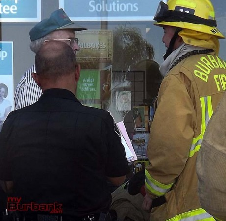 Police and Fire personal talk to the driver after the accident   (Photo By Nick Colbert)