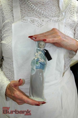"Member Sue Ann Gordon holds a Lladro piece titled ""Girl with Calla Lilies""    (Photo By Joyce Rudolph)"