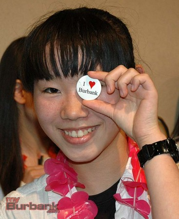 Ota student Yuka Saito checks out her I Love Burbank lapel button   (Photo By Joyce Rudolph)