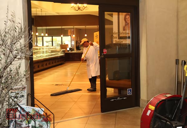 Porto's employees were able to continue their night cleaning duties, after the smoke cleared. (Photo by Ross A. Benson)