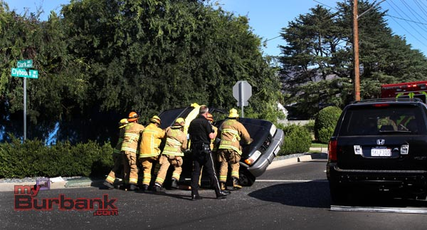 Burbank Firefighters upright one of the cars involved in this minor injury auto accident Thursday afternoon. (Photo by Ross A. Benson)