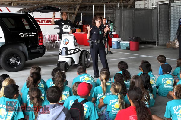 Bob Hope Airport Police Officer Irma Albao tells the campers what Airport Police Officers do. (Photo by Ross A. Benson)
