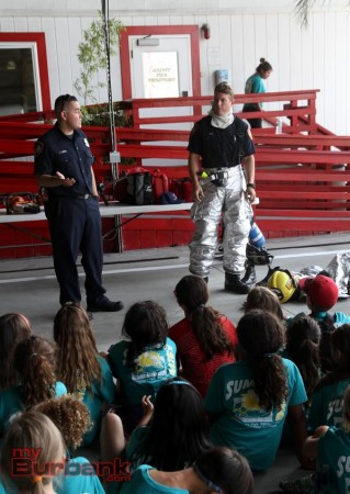Bob Hope Airport Firefighter shows his safety suit to camper visting.(Photo by Ross A. Benson)