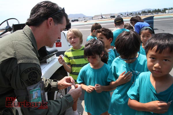 Glendale Police Pilot Sean McLaughilin gives campers pilot wings. (Photo by Ross A. Benson)