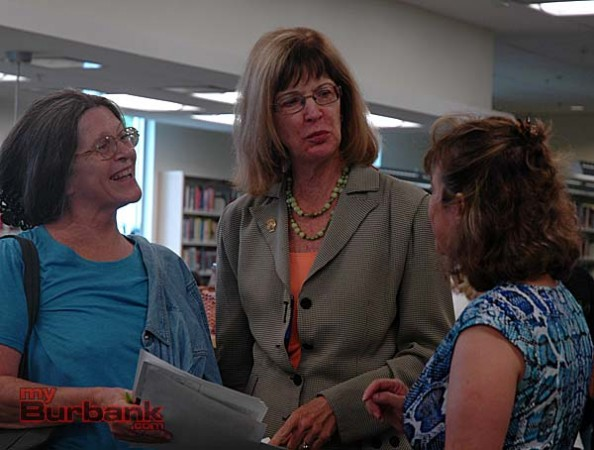 Pam Jerome, left, and Nancy Guillen, right, talk to Mayor Emily Gabel-Luddy about the renovated Northwest Library on Saturday. (Photo By Joyce Rudolph)