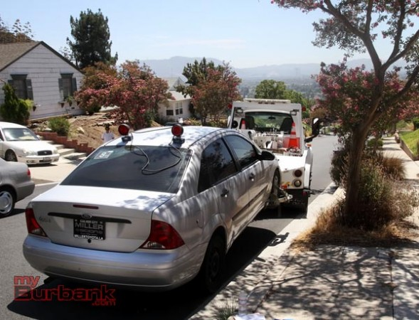 The vehicle driven by the suspects was impounded by the Burbank Police as they search for evidence  (Photo By Ross A. Benson)